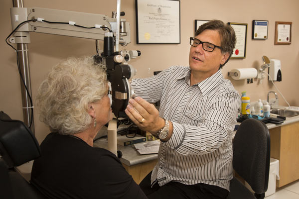 Dr Neumann with a patient - Central Saanich Optometry - Optometrists in Saanichton, BC